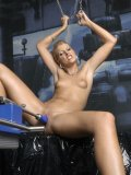 Sandy Sunshine with long legs and smooth pussy enjoys fucking machine's blue dildo