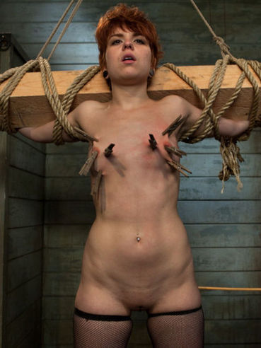 Red-haired girl Juliette March with shaved pink pussy gets banged by Wolf Hudson after torture