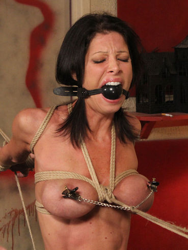 Big titted tied up brunette Little Angel gets her bare pussy punished and stimulated to orgasm