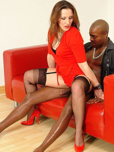 Sexy lady Cate Harrington dressed red and black plays with black man meat