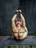Lea Lexus is smoldering hot in bondage and hurt by her master who knows his bdsm stuff