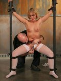 Enslaved blonde Sara Faye in white stockings gets bound, dildoed and wax covered