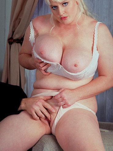 Chubby blonde Heather Michaels gets her juicy tits eaten and her pussy rubbed by hot guy