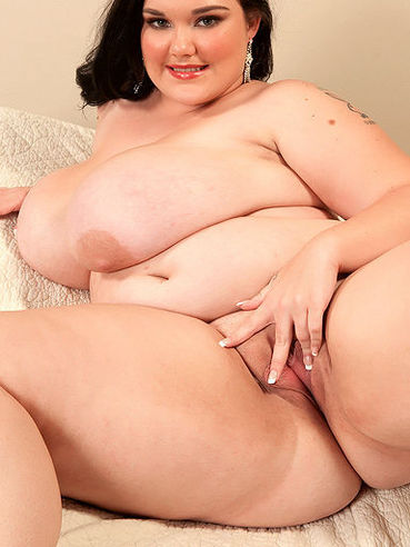 BBW Lisa Canon licks her big tits and takes off her underwear to show her big bare bottom
