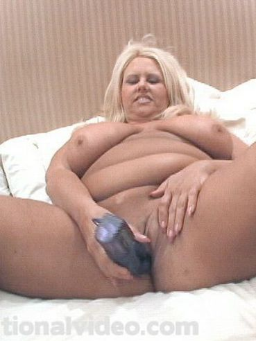 Thick blonde Buxom Candy with shaved pussy spreads her legs and inserts toy  in her hole
