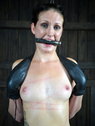 Slim slave brunette Hailey Young gags on dildo and gets her shaved fat lipped pussy tortured