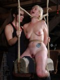 Blue-eyed blonde Niki Nymph gets tied up by brunette  Sister Dee after leaving the cage