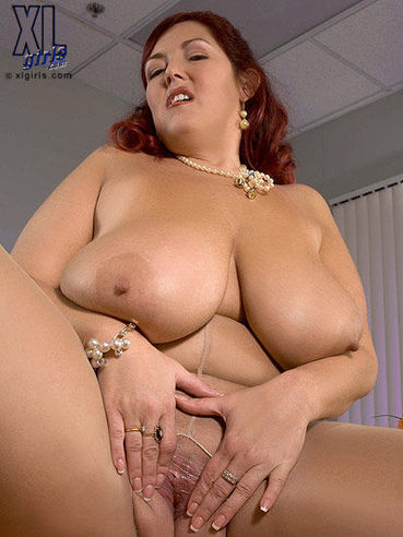 Plump Peaches Larue in sheer pantyhose takes off her bra and takes red dildo in her fuck hole