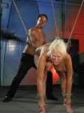 White haired busty slave girl Carly Parker gags on cock and gets cornholed