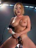 Amazing babe Krissy Lynn with hot curves stimulates her clit while the machine screws her.