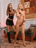 Debbie White gets her bald pussy tweaked and sexy ass spanked by clothed Peaches
