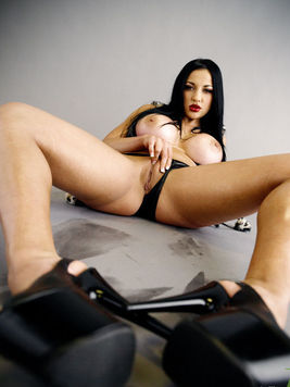 This is the horny babe Audrey Bitoni that is boasting her beautiful long legs and huge globes