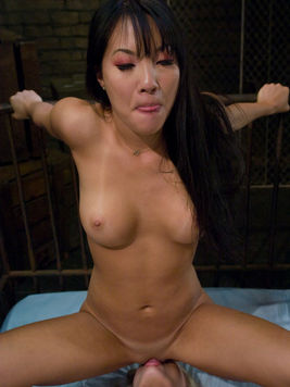Asian mistress Asa Akira feeds her pussy to her bound slave Sunset Diamond then humps her