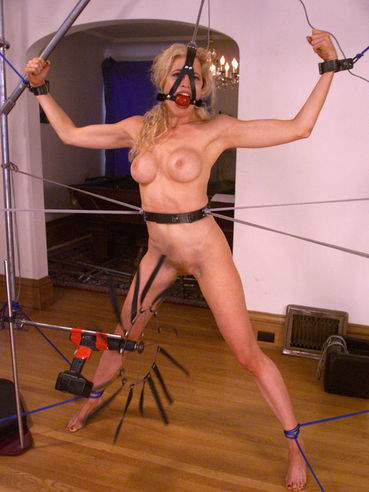 Nude perfect bodied blonde Sadie Belle with sexy round boobs gets restrained in the living room