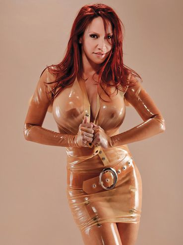Busty redhead Bianca Beauchamp in see through rubber blouse and panties exposes her huge round tits