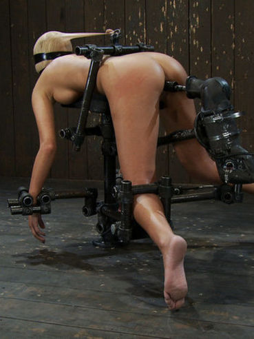 Beautiful blonde Breanne Benson with adorable body gets bound doggy style 10 inches over the floor
