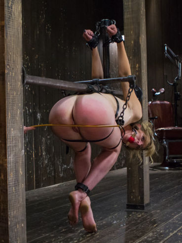 Slim blonde Mona Wales gets spanked like a real naughty girl while being tied up on the floor.