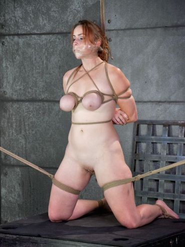 Red-head Bella Rossi tangled in ropes and gets her body bondage stretched and filled with plastic.