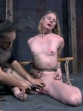 Slender small titted naked slave woman Renee Blaine gets caned by domina Sister Dee