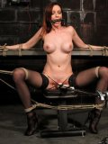Slave girl Emily Marilyn in stockings gets her legs spread for pussy stimulation