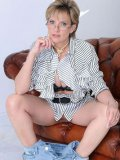 Gagged milf Lady Sonia pulls down her tight blue jeans and exposes her pussy