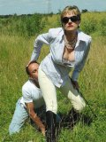 The luscious Lady Sonia makes guy sniff her ass and tramples his body outdoor