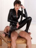Mature mistress Lady Sonia in black latex body suit playing with her helpless male slave