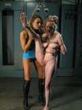 Rain DeGrey gets her pink pussy fucked by Nika Noire's fake cock after spanking and torture