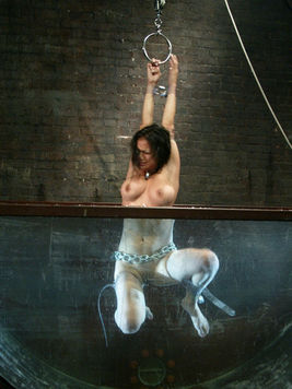 Nadia Styles dipped in water and moaning, screaming while put into a aquaphilia situation.