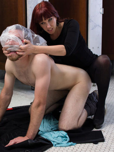 Auburn haired Maitresse Madeline gets a man's cock tightly in her hands while femdom stimulating.