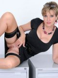 Lady Sonia in black dress and stockings makes no secret of her big jugs and shaved twat