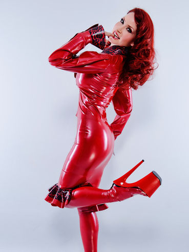 Bianca Beauchamp poses in red dress, stockings and undies made of latex