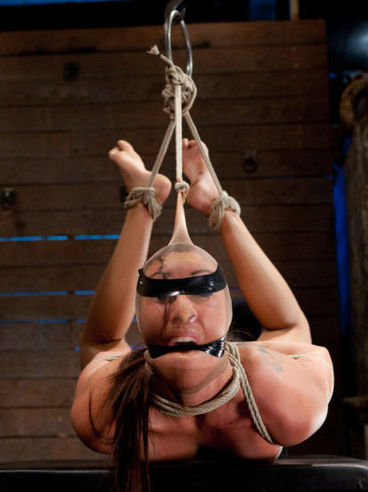 Nice brunette Vivian Vista loves to hangs gagged and hogtied with a plastic wrap on her face.