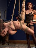 Dark haired Yhivi gagged and in ropes while bondage lover Bella Rossi takes her into her hands.