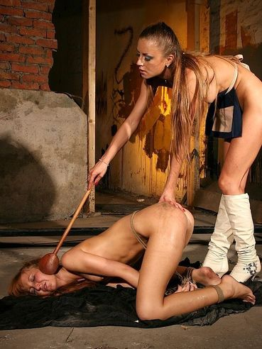 Gilda Roberts in high white boots punishes Baby Silver as hard as she can