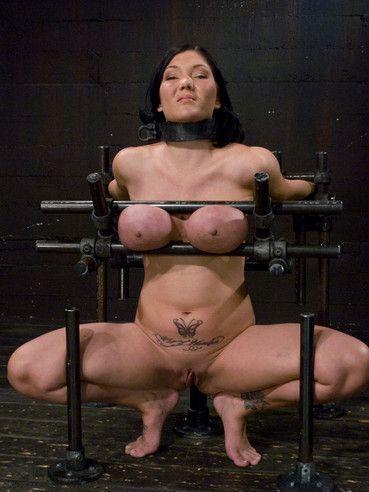 Naked curvy brunette Claire Dames gets her colossal tits punished in device bondage.