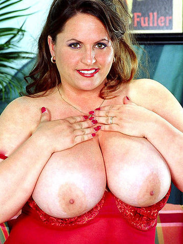 Brown haired fattie Gina Marie La Montana in red nightie shows off her big breasts