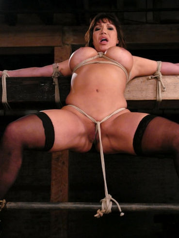 Massive titted exotic slave woman Ava Devine in black stockings gets bound and caned