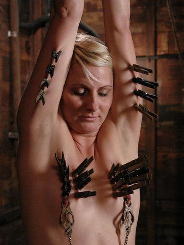 Short haired bound slave blonde Vendetta gets her shaved snatch tortured