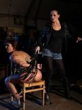 Maria Bellucci gets tied up with hands behind her back and whipped on a chair by Mandy Bright