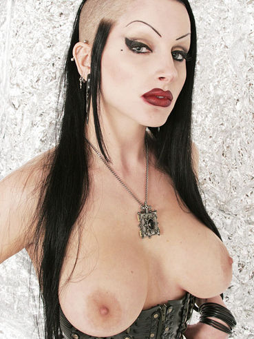 Alternative brunette Vampirabat in latex skirt and leather corset shows off her nice melons