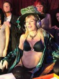 Lovely brunette gets her juicy tits out for curious mature lady Susan Block at a fetish party