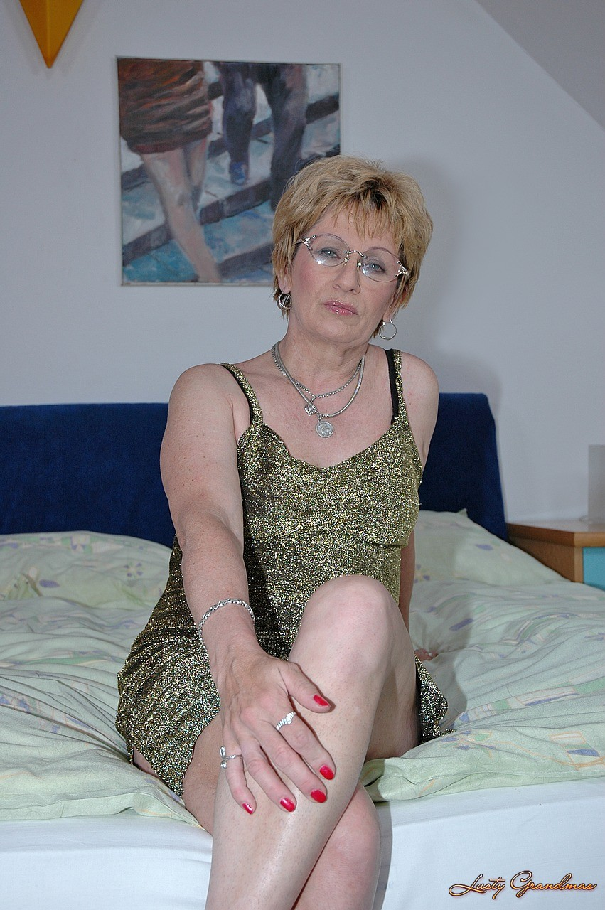 nasty granny mabel plays with long dildo before boy offers his stiff