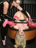 Big titted slave blonde in pink latex stockings and her glassed mistress Nikki Nefarious