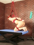 Redhead AnnaBelle Lee gets tied and suspended by lesbian domme Natali Demore before anal punishment.