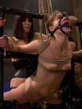 Sensi Pearl gets her face and holes fisted by Bobbi Starr who chains and ties her during bondage.