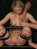 Lexi Belle gets restrained with straps before torture and pussy stimulation