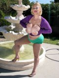 Big thick blonde Samantha 38G poses right in the sun and pulls out her massive tits