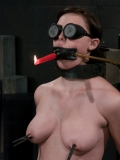 Masked slavegirl India Summer holds burning candle with her lips and gets eaten out by Brooke Adams.