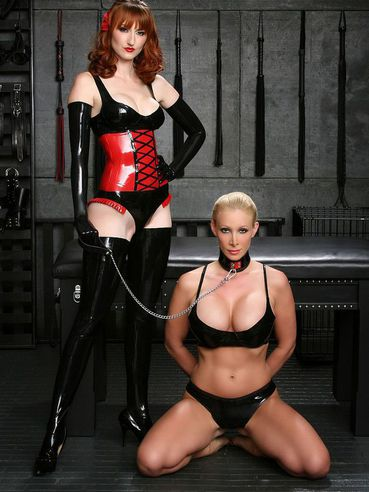 Busty slave blonde with shaved snatch opens her legs for redhead mistress Kendra James